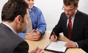men and lawyer discussing on agreement